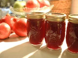 Pomegranate jelly recipe, made with the juice from sweet red seeds of fresh pomegranates, lemon juice, sugar, and added pectin.