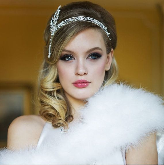 This stunning rhinestone bridal headband is reminiscent of the Gatsby, Downton Abby era. Ribbon tie back. Replica of the Daisy Buchanan