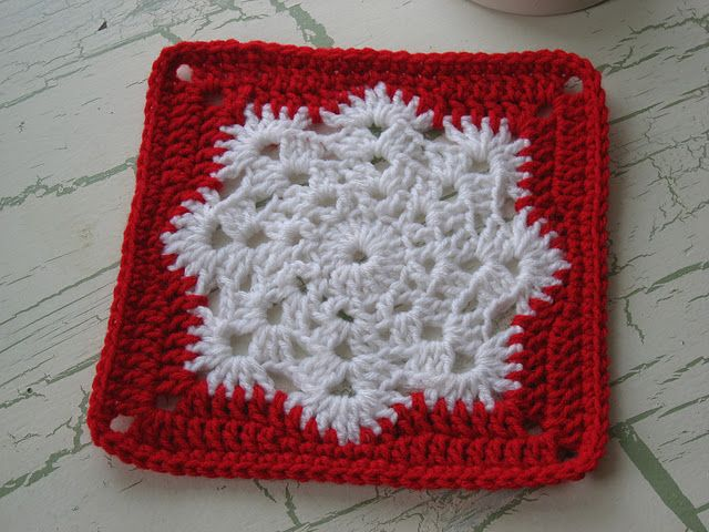 Snowflake granny square - free crochet pattern here: http://web.archive.org/web/20090607063420/http://www.lindaslists.net/snowflakeph.htm