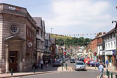 Newtown (Welsh: Y Drenewydd) is the largest town in the county of Powys, Wales. It had a population of 12,783 in 2001, falling to 11,357 at the 2011 census. Lying on the River Severn, within the historic boundaries of Montgomeryshire, the town is best known as the birthplace of Robert Owen in 1771 ~ Wikipedia