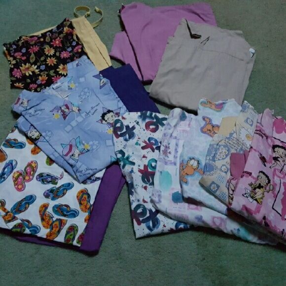 Womens scrubs 5 pair of Womens scrubs pants, shirts and jackets. All in great condition. Other