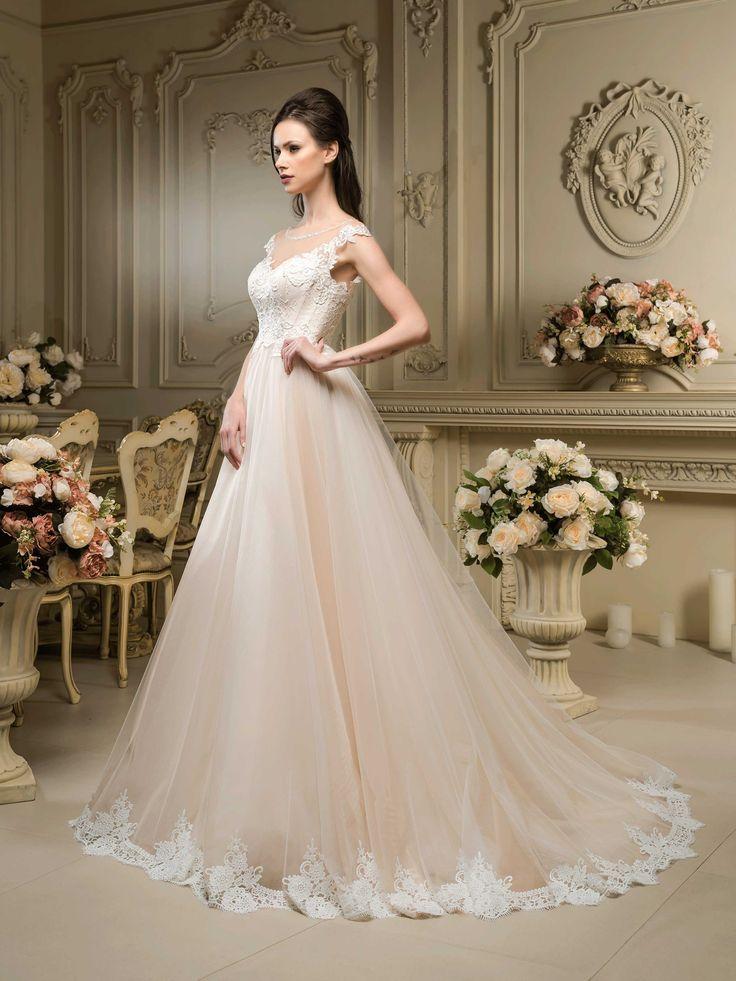 Očarujúce svadobné šaty s čipkovaným živôtikom a širokou sukňou zdobenou čipkou