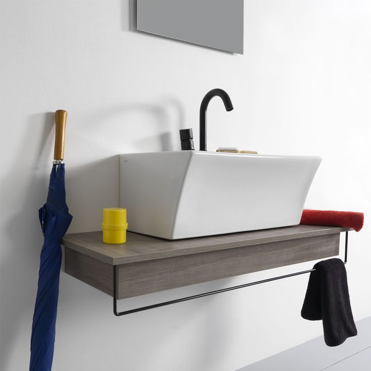 BLOCK 60x35 ceramic washbasin available in overtop and wall-hung versions. The compact size of the design makes it easy to use in all spaces, even the smallest. Maximum functionality with very little space occupied. Customisable textures and ironic accessories