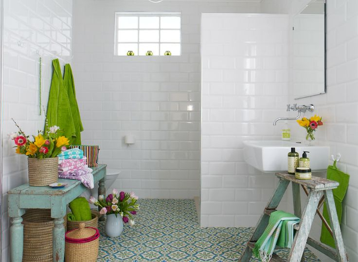 White bathroom with a twist ...and beautifull floor tiles  ...