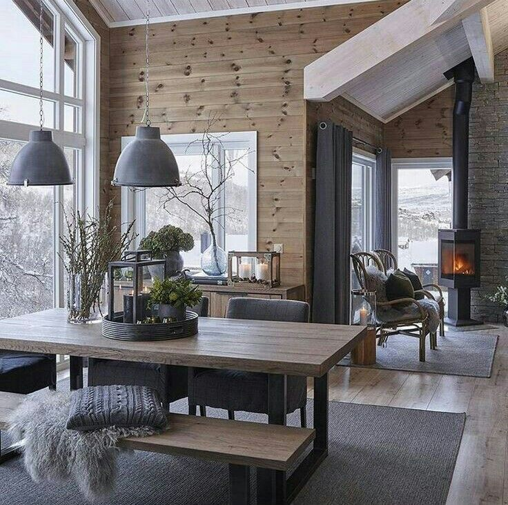 Love the wood stove taking up little space and the whole table area.
