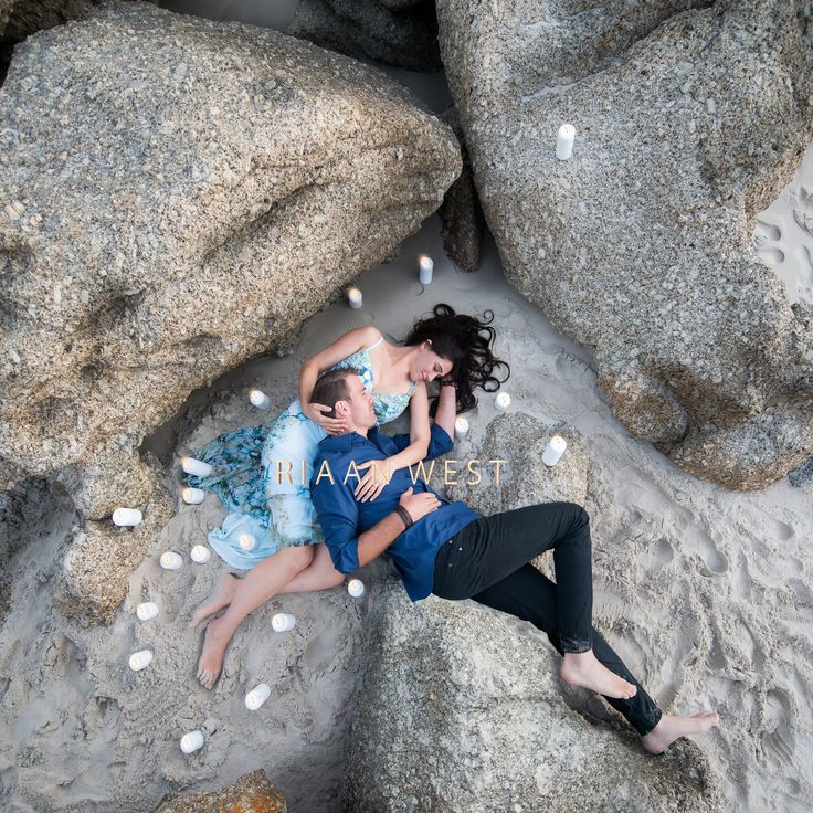 There is something #Romantic about this photo. I love the way Yves connects with Luanne. Wesley my Assistant was a great help, getting the screen and the #candles ready to do shoot this images. We scouted several places and this was by far the best spot. The #Rocks makes it very interesting #RiaanWest #FineArtweddingphotographer #BeachEngagements #CreativeEngagements #CapeTownEngagements #Art #EngagmentPoses #CoastalEngagements #Llandadno #Beach #engaged #Ido