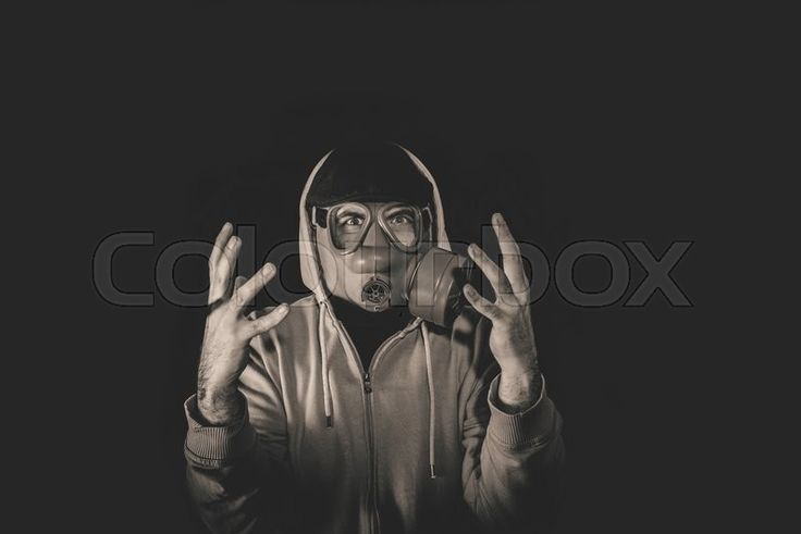 Stock image of 'Angry man wearing gas mask,low key and monochrome'