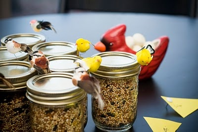 Party favors? Bird seed in jelly jars.