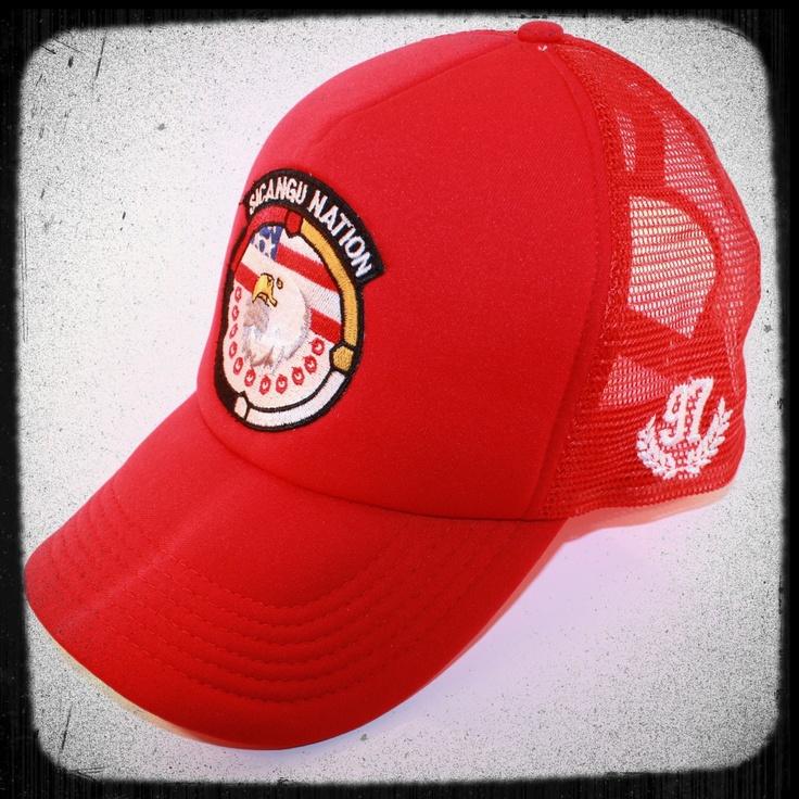 Sicangu Nation red trucker hat.