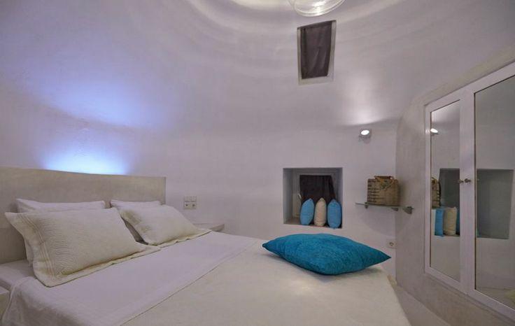 The WindMill Villa Bedroom with #Caldera view. Ideal for the honeymoon of your dreams   #Santorini #Greece #Oia #Villas #Luxury #Holidays #Honeymoon #Romance  Antonis Eleftherakis Photography. All Rights Reserved.