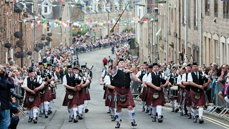 Galashiels Pipe Band coming up Scott Street on Braw Lads Day