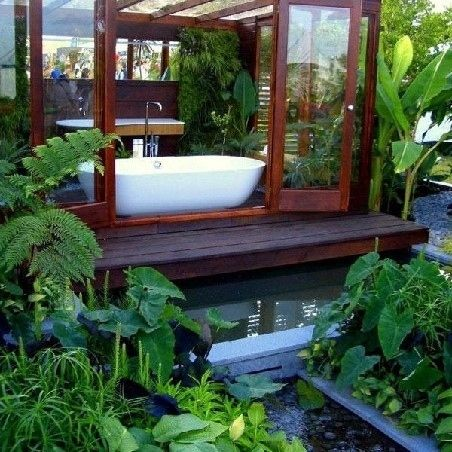 I love how this is an outdoor bath with the option of closing the doors, and the greenery looks beautiful.