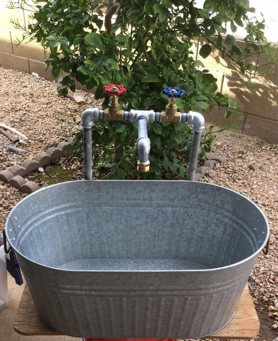 Oval Laundry Sink With Industrial Galvanized Faucet In 2020 Laundry Sink Outdoor Garden Sink Galvanized Tub Sink