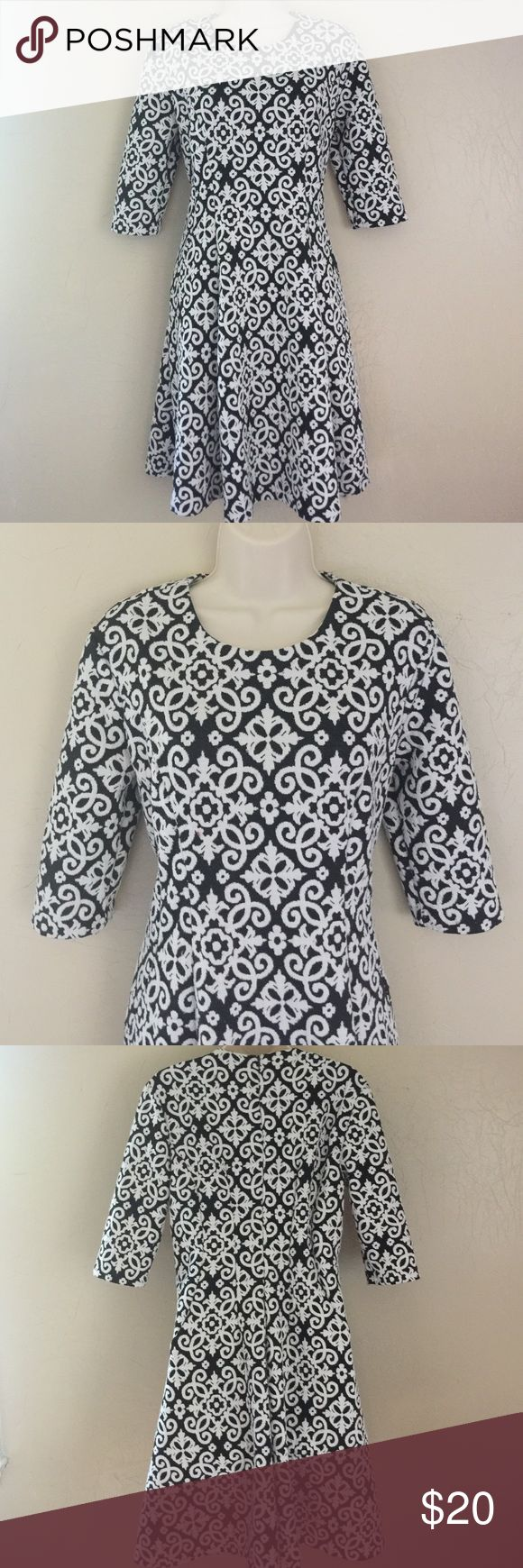 Fit and Flare Cato Dress Beautifully chic dress by Cato. Black and white and is super flattering. 97% Polyester and 3% Spandex. Has a zip down the back. Wore it with the red coat I have listed and was perfect! Amazing with tights and heels or leggings and boots! 💕 Cato Dresses