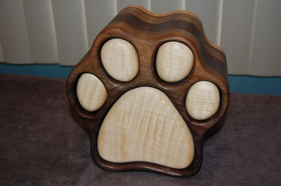 Handcrafted uniquely designed dog paw print jewelry box. Two sided, each paw pad slides both ways and opens to both sides. Each draw is lined.  Please note that variations in the wood coloring are normal as every piece of wood is different.  The one shown is the large. If you want one of a particular color variation such as multi colored as in the top right picture, light paw pads with dark surrounding area with opposite side of light surrounding area with dark paw pads.  Any variation can…