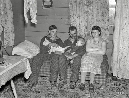 """December 1936. """"William Helmke, wife, baby, and brother live in one-room shack on ninety-acre farm near Dickens, Iowa, owned by lawyer."""" Medium format negative by Russell Lee for the Resettlement Administration. Prints from $15."""