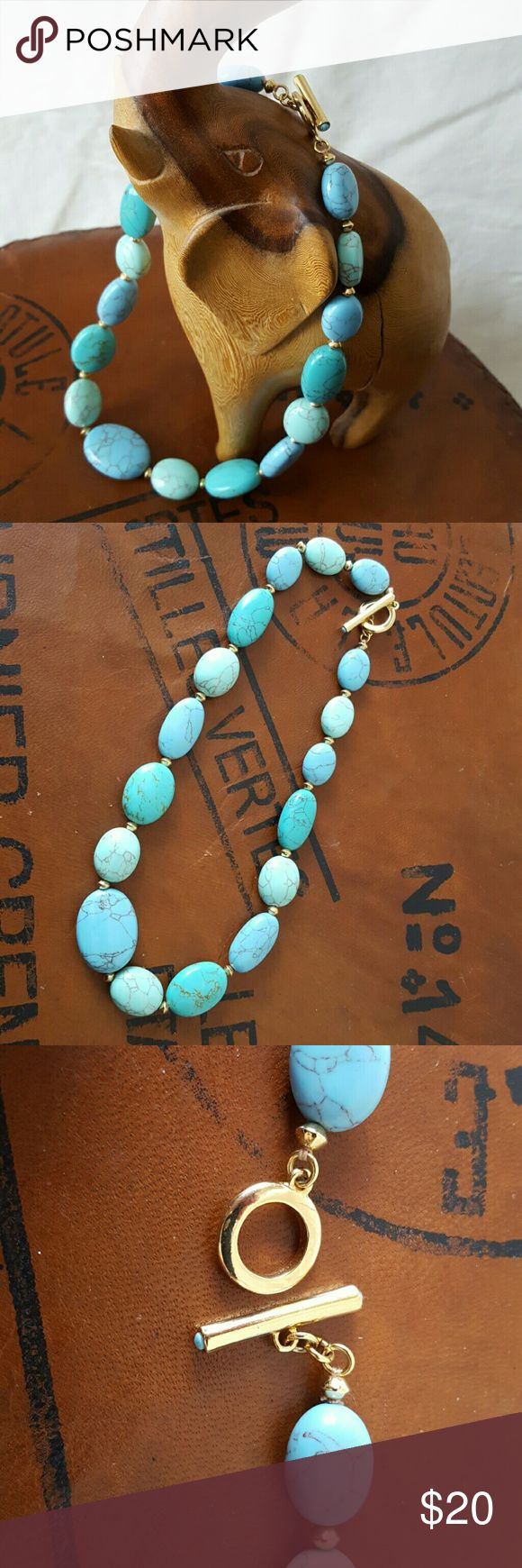 Ralph Lauren turquoise bead necklace High quality, costume jewelry necklace. Faux turquoise stones with gold stations. Choker length. Pretty toggle closure. Excellent condition. Looks lovely with white dresses! Ralph Lauren Jewelry Necklaces