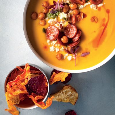 Butternut soup with chorizo, chickpea and feta topping