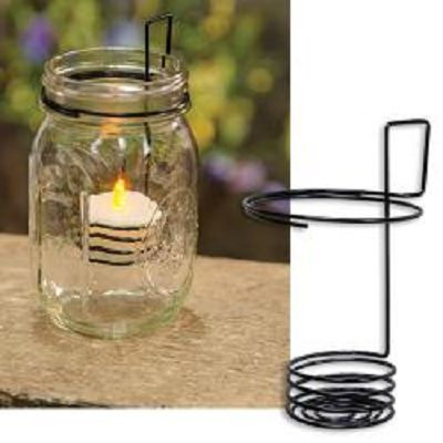 """Mason Jar Tealight Holder ~  is made of sturdy black metal. It has a round mouth that fits over a Mason jar and an attached spiral piece that goes inside the jar and holds an LED tealight. Measures 4"""" high by 2¾"""" wide. Tealight candles sold separately."""