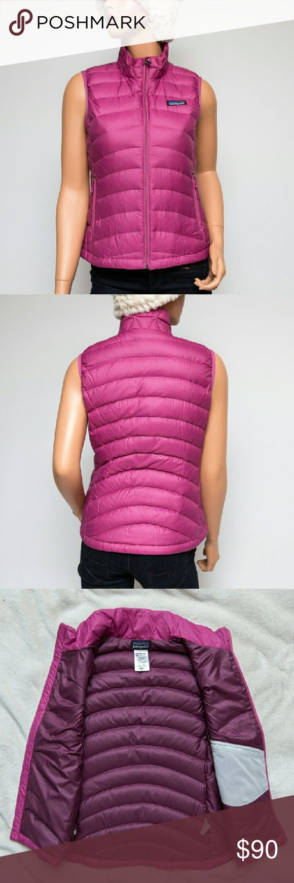 """Patagonia Pink Down Sweater Vest Puffer 84627 This is a lovely 800-fill pink down sweater puffer vest by Patagonia! It has been very lightly worn (see how bright and crisp the tag is---this is the first to fade when laundered a lot---I live in Florida with not many chances to wear puffers, but I love buying them). It has no loose threads, no stains, no rips or holes. It is made with 100% polyester, has a 100% polyester lining, and 90% minimum down insulation. It is 21.5"""" long and 17.5""""…"""