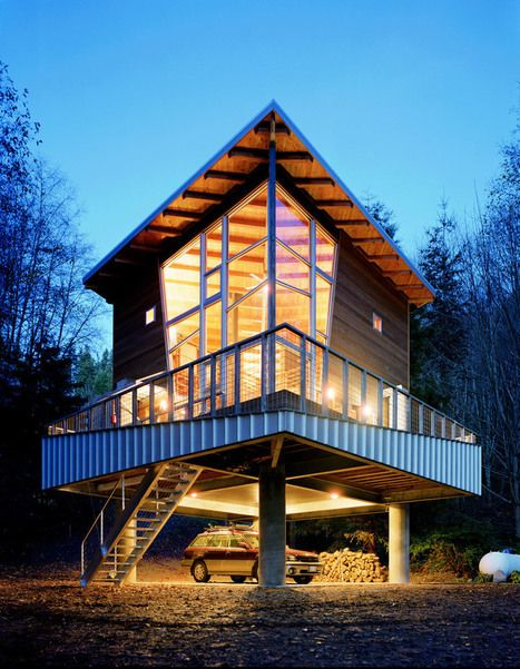 A single-level 800 sq ft home with 16′ ceilings and partial loft on The Hood Canal in Washington. The high ceilings make it seem so much larger. Designed by Castanes Architects. | Tiny Homes