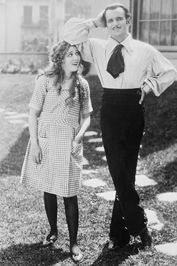 Mary Pickford & Douglas Fairbanks, he in dancing Costume of a Flamenco dancer