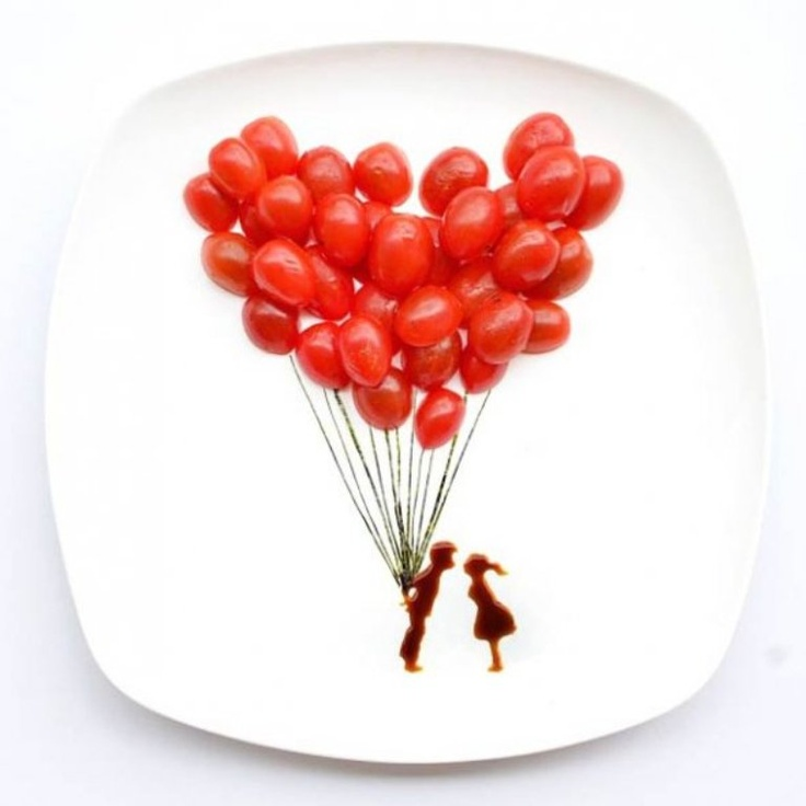 Cherry tomato balloons above kissing couple