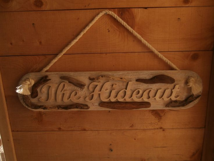 Driftwood house name sign with hand cut lettering