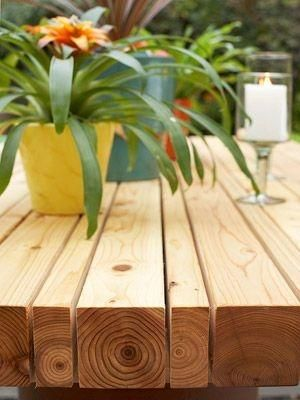 Just 4x4's and 2x4's spaced 1/4 inch apart and screwed together with more 2x4's cut one inch shorter than the width of the table. seal it and its a great outdoor table for the patio! by liza