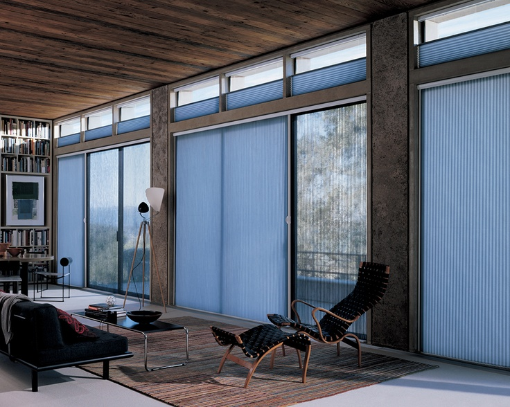 Duette honeycomb shades with Vertiglide offer a modern design statement  for this chic loft
