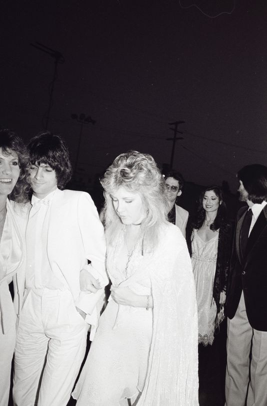 Stevie Nicks, Jimmy Iovine, Lori Nicks, Kim Anderson and Sharon Celani arrive at the 10th Annual American Music Awards in Los Angeles on January 17, 1983