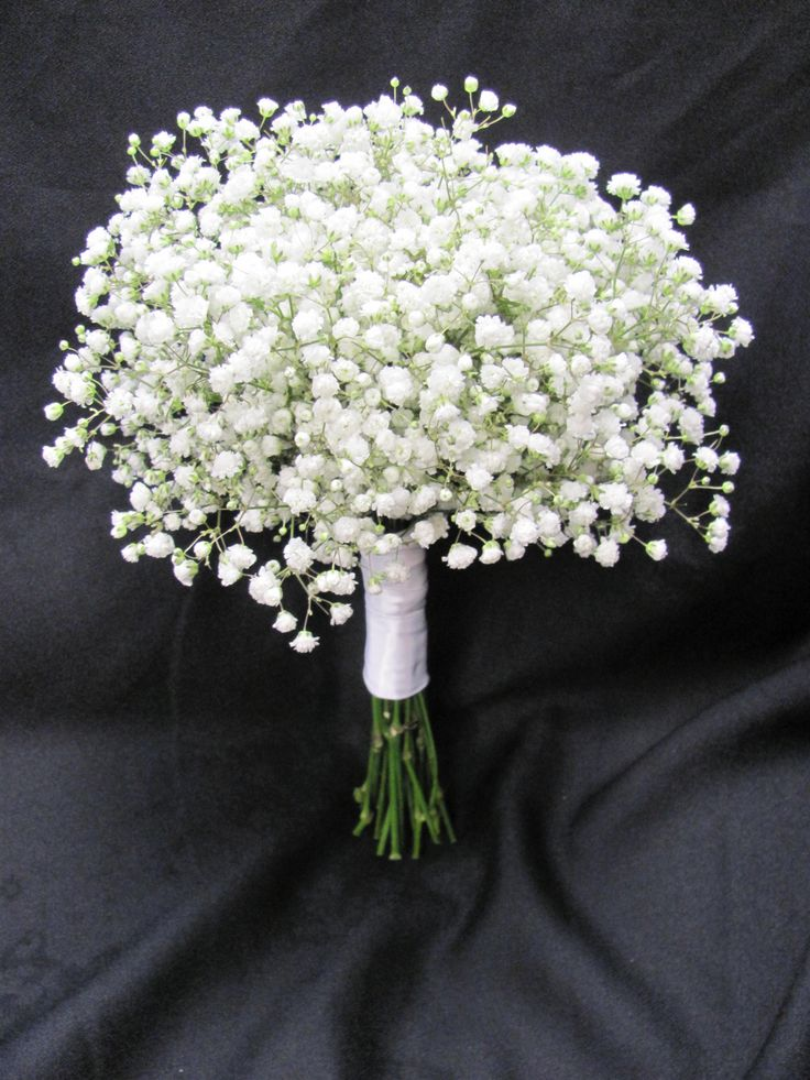 Bridesmaids bouquet of babies breath.. simple but pretty