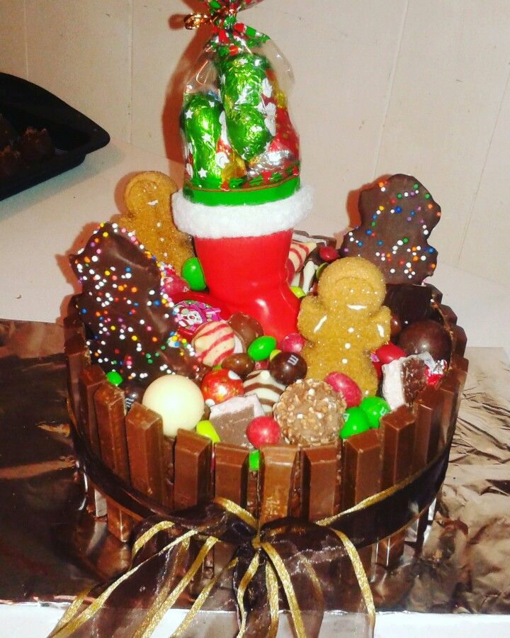 Christmas Kit Kat Cake with Gingerbread Peeps, Lindors, Marshmallow Trees, Ferrero Rochers, Skittles, M&Ms, Strawberry Aero Bars, Hersheys Kisses & Hugs, Candy Cane Kisses and more