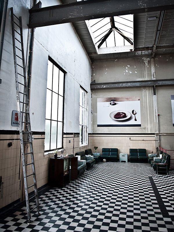 black and whtie floor, high ceilings, skylight