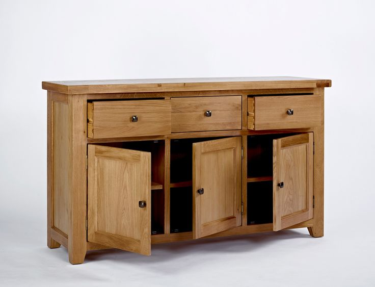 Devon Oak 3 Door 3 Drawer Sideboard modern chunky styled dining furniture. Visit http://solidwoodfurniture.co/product-details-oak-furnitures-5124-devon-oak-door-drawer-sideboard.html