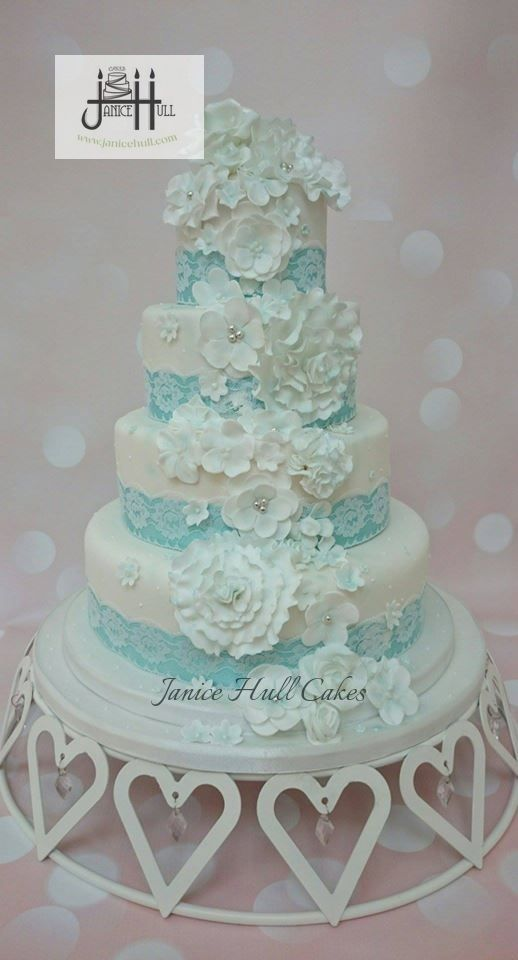 A beautiful turquoise and white wedding cake by Janice Hull Cakes