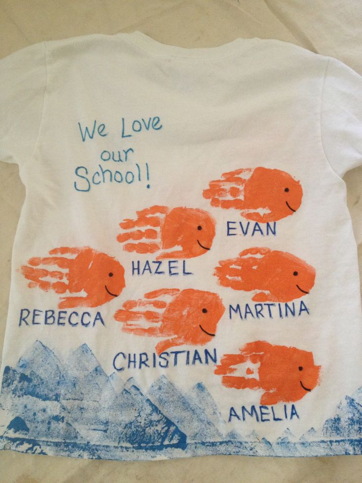"""End of year class t-shirts; handprint fish t-shirts; front side has name of school and year; back side has """"we love our school"""""""
