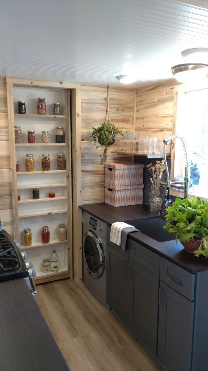 A pantry pocket door with storage on both sides provides shelving to both the kitchen and bathroom.
