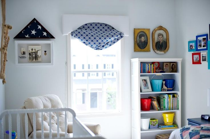 We love the idea of adding sentimental family items such as the flag & Purple Heart award from this baby's great-great uncle.: Families Photos Items, Families Items, Neat Ideas, Cribs Close, Baby Rooms, Baby Birds, Baby Numbers, Nurseries Ideas, Baby Nurseries