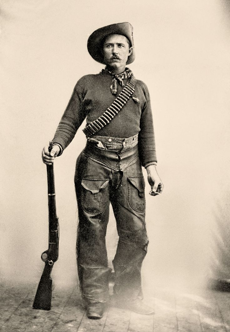 This Ranger, whose identity is lost to time, is dressed in functional cowboy gear that is typical of clothing worn by the Rocky Mountain Rangers. His hat identifies the one concession to military dress code: the upturned brim signifies affiliation with the Canadian Militia. The 1876 Winchester .45-75 was the Rangers' weapons of choice. This Ranger also has a Smith & Wesson New Model No. 3 single-action revolver tucked in in his chaps.  – Courtesy Glenbow Archives NA-670-5 –