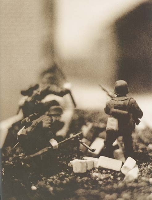 Hitler Moves East: A Graphic Chronicle, 1941-43 is a unique photography project from US artists David Levinthal and Garry Trudeau that was originally published in 1977.  While all the images are photographs, they're actually all of toy soldiers arranged upon a series of intricately modelled dioramas.