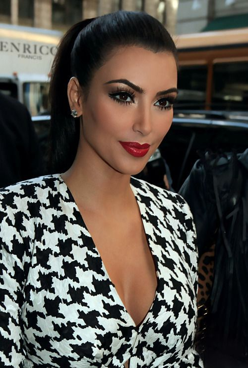 Kim Kardashian in business chic outfit with perfect makeup.