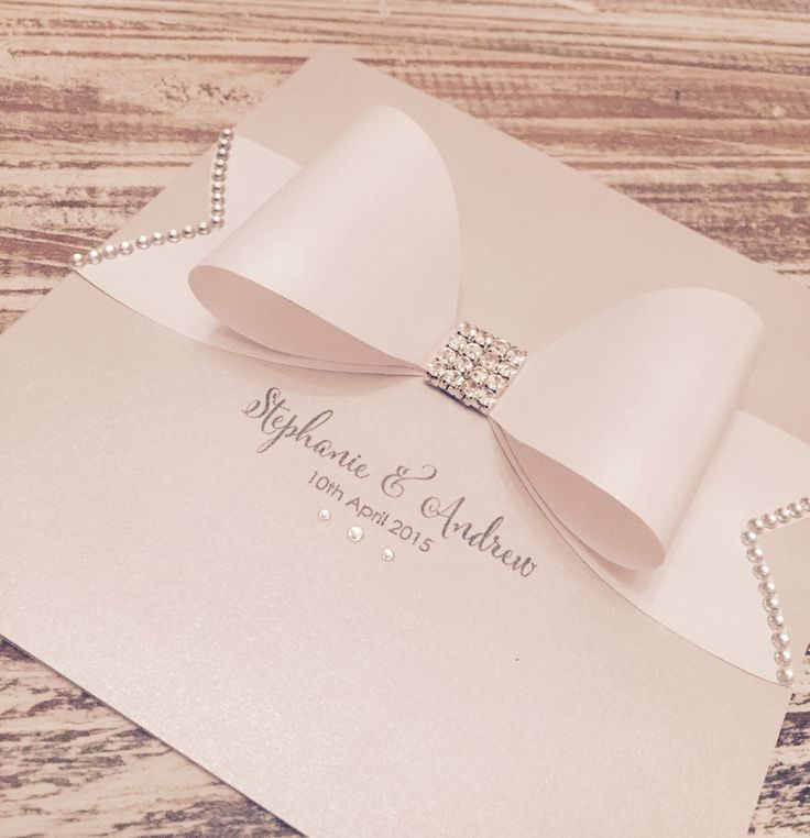 Beautiful simple invites with a white paper now and diamante