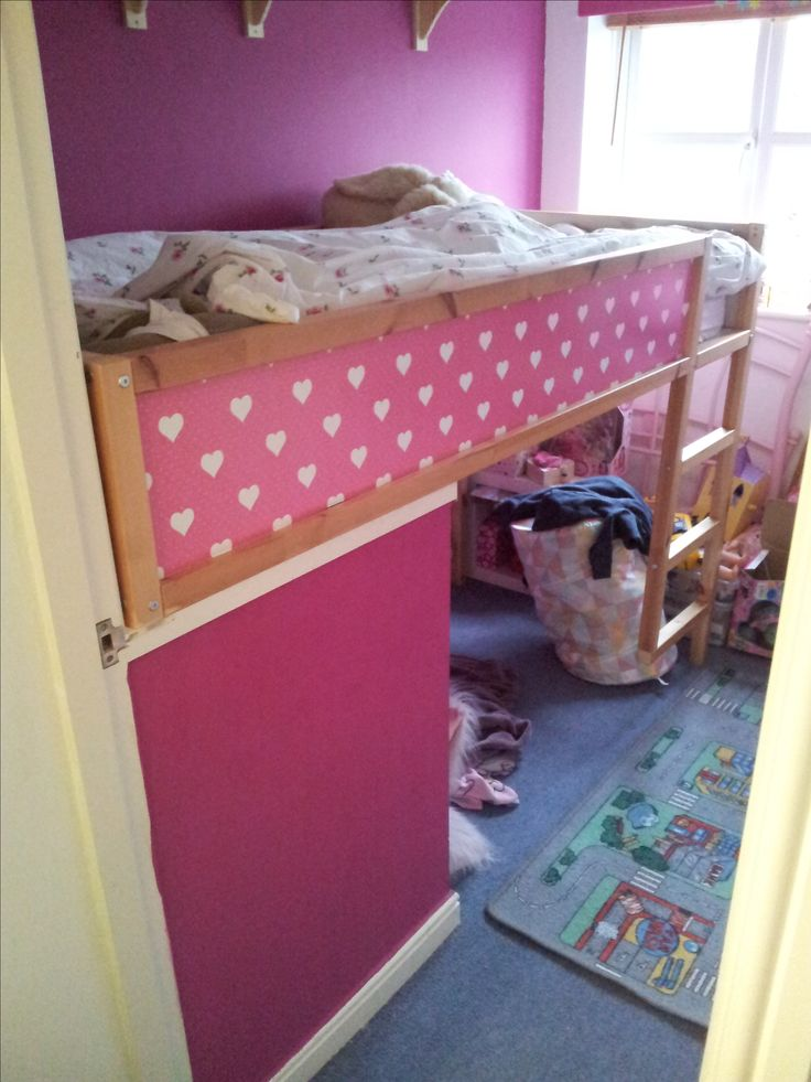 The IKEA Kura bed was slotted onto the bulkhead. We sawed off the front legs and had to extend the bottom legs with the remaining timber. We then secured the bed in several places. We used vinyl to pattern the side pieces to match the room.