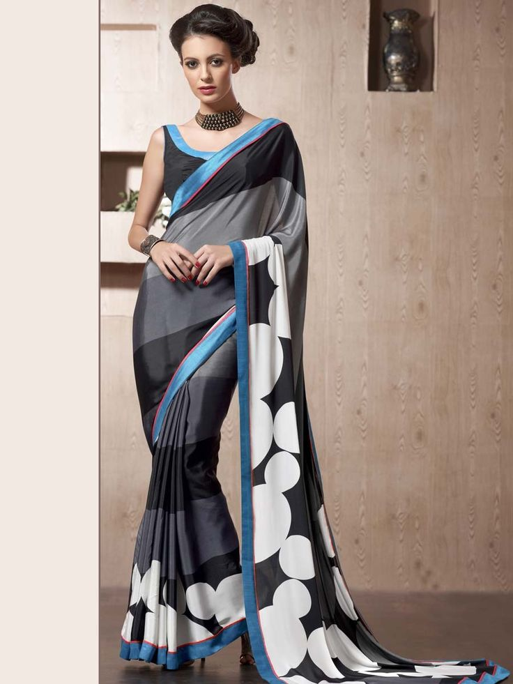 Fascinating satin saree in black, grey color with stripes, bold dots print and fancy patch border. Item Code: SDHI1860 http://www.bharatplaza.com/new-arrivals/sarees.html