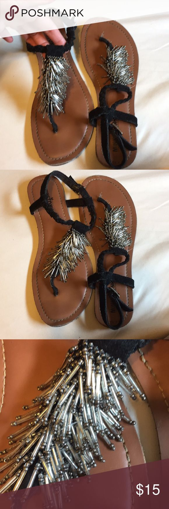 Minnetonka sandals-black suede breaking with beads Size 7. Minnetonka sandals. Gently loved, good condition. Black suede braided straps with silver embellish beading! Adorable to wear! Minnetonka Shoes Sandals