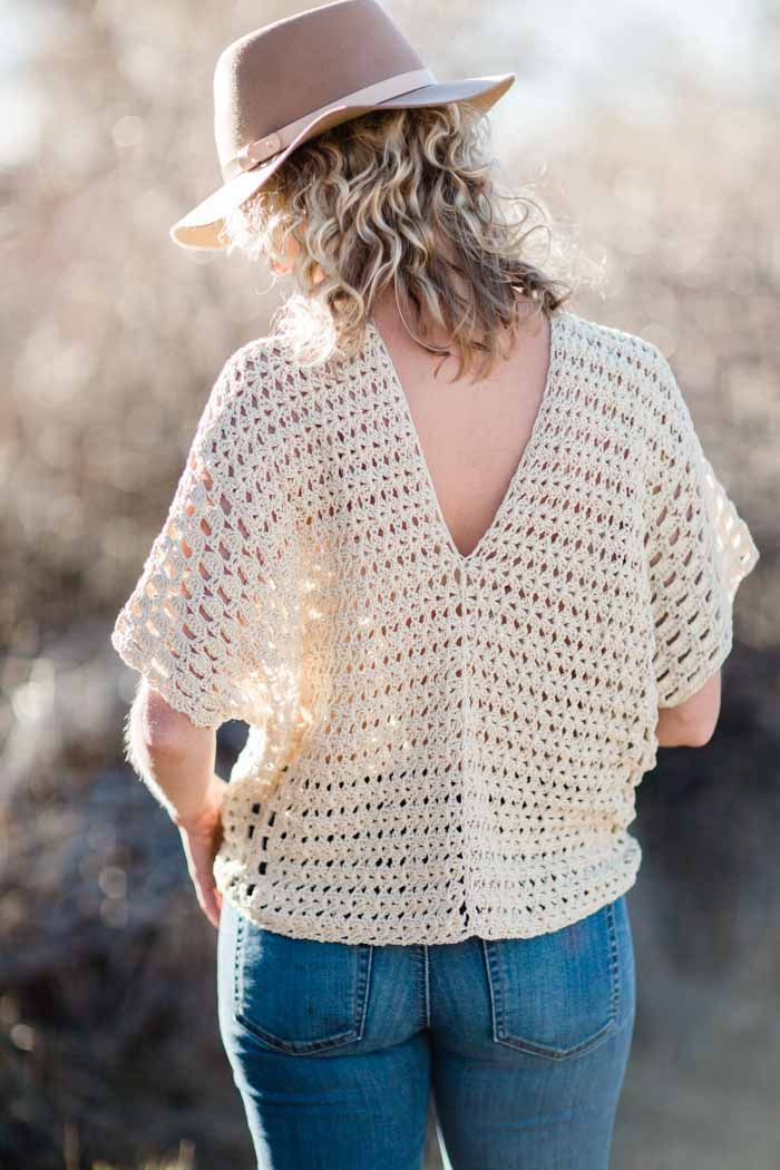 Made from two simple rectangles, this poncho-style summer crochet top with an open back will give your outfits a boho vibe all season. Free crochet pattern using the Iris Stitch and the Boxed Shell Stitch, featuring Lion Brand Yarn LB Collection Cotton Bamboo.