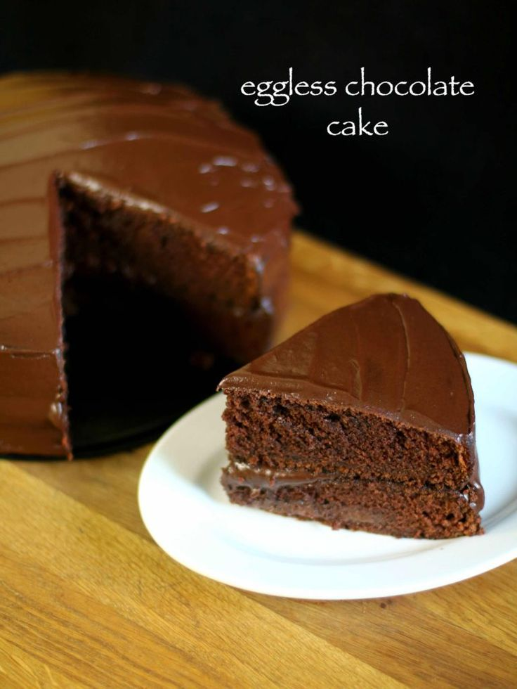 eggless chocolate cake recipe, eggless cake, basic chocolate cake with step by step photo/video recipe. a moist & spongy cake recipe with chocolaty frosting