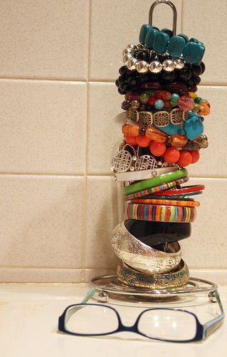 Paper towel holder reused for bracelets - I tried this and it works great. Mine holds rings too on a smaller rod that is connected. Mine is wooden so styles vary. Fun!!