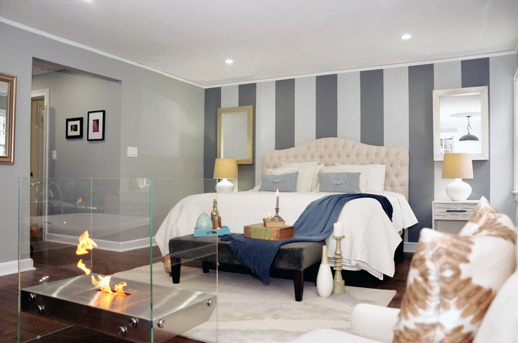 A striped wall in neutral tones creates another focal point of the room without disrupting its calming vibes. #CousinsOnCall    https://ecosmartfire.com/collection/